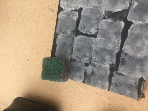 """Stamp the sponge into stone-ish shapes, forming a grid-ish pattern (it can be used as a """"battle-grid"""", roughly, for those who play that way)."""