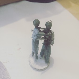 Zombie couple dancing. Painted and mounted.